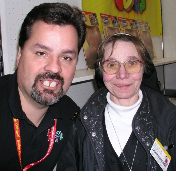 Geoff Bevington and a German Nun at the Billy Bob Teeth and Tekky Toys booth during the 2002 Nuremberg Toy Fair.